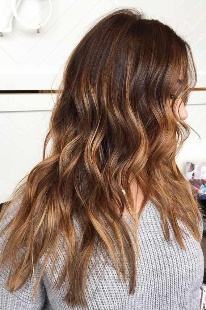 Dark brown hair color adds a mystery to the overall look. One can find different...