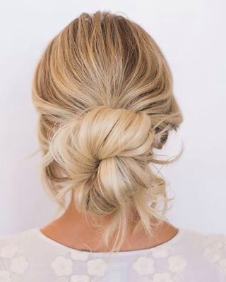 The perfect summer blond messy bun...