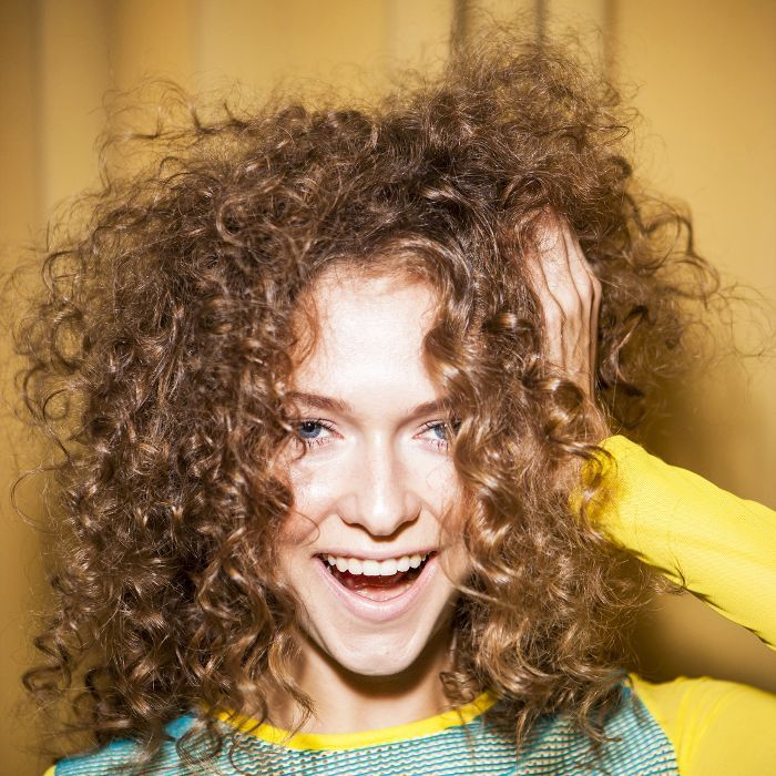 Top hairstylists share their tips for how to fix frizzy hair. Read them inside!...