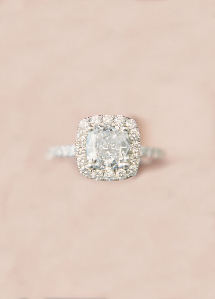 Cushion-cut engagement ring in a halo setting: Photography: Joseba Sandoval - ww...