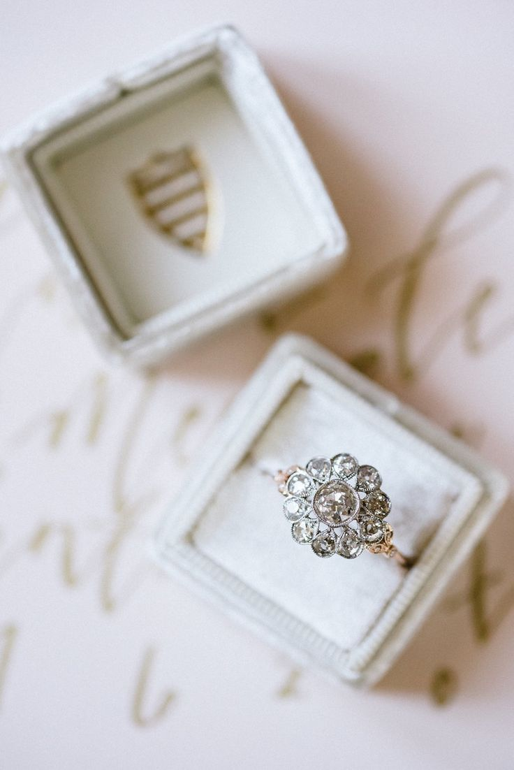 Floral engagement diamond ring | Photography: Melanie Julian...