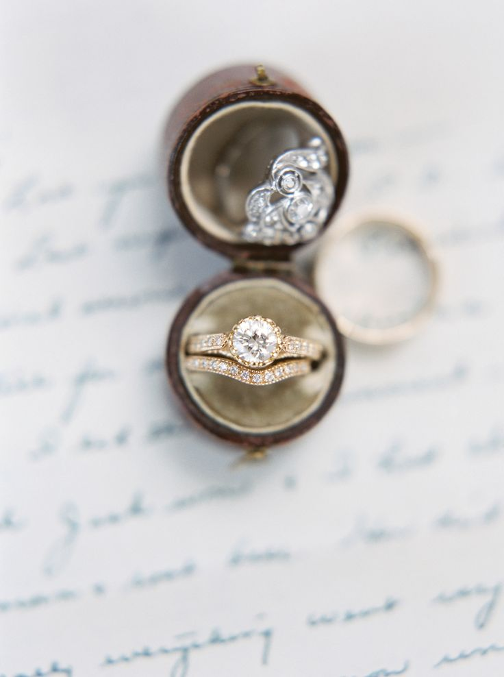 Gold band circle-cut engagement ring | Photography: Kim Stockwell...