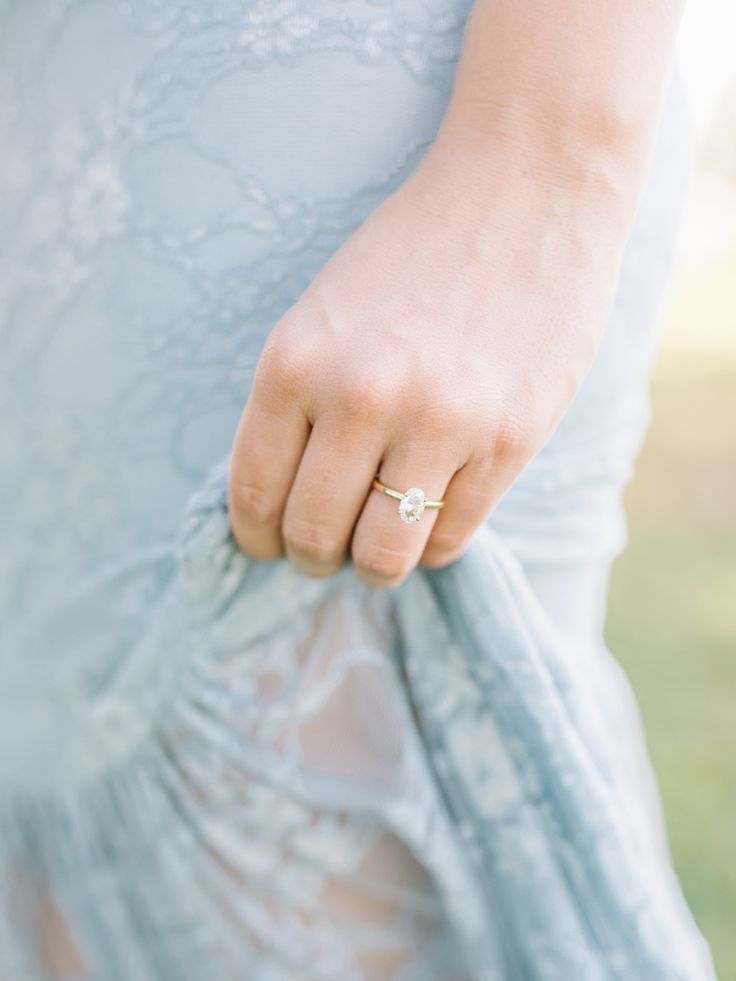 Oval-cut engagement ring | Photography: Tenth & Grace...