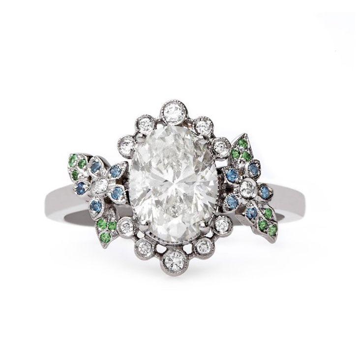 Oval-cut unique engagement ring:...
