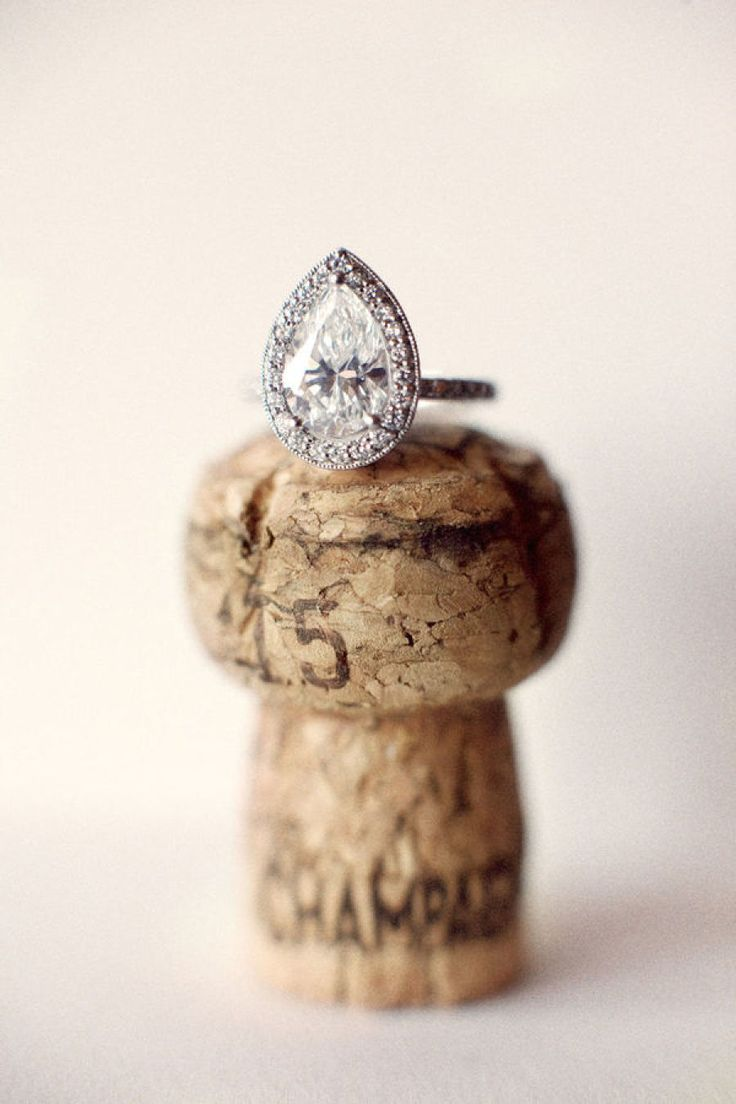 Pear-cut engagement ring in a halo setting: Photography: Aaron Delesie...