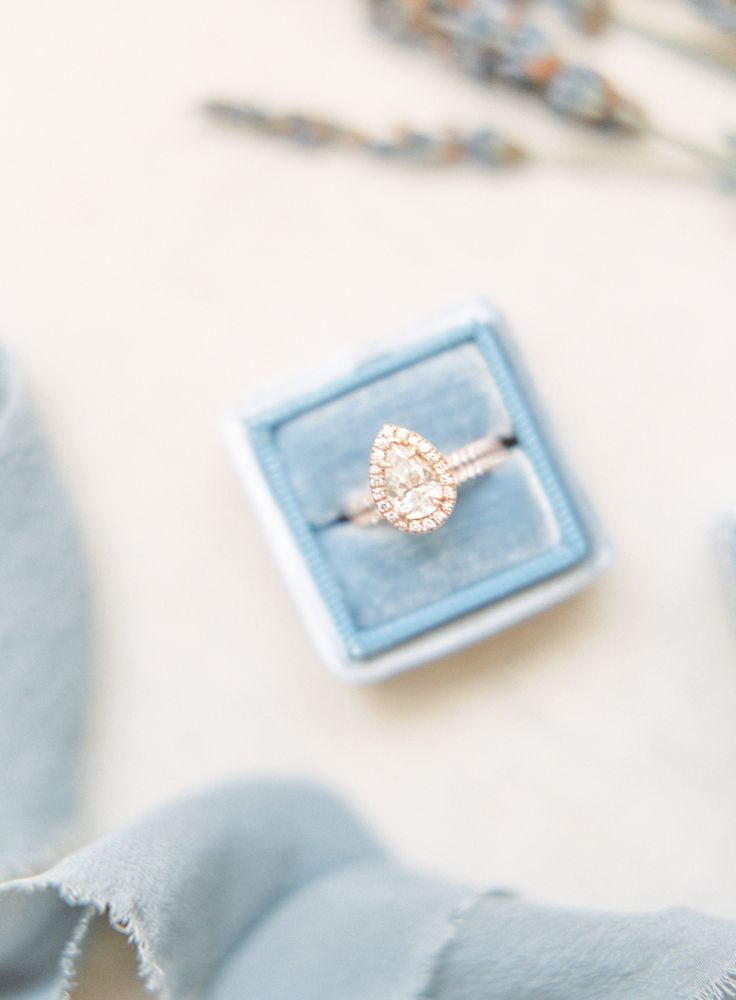 Pear-cut engagement ring in a halo setting: Photography: Kristina Adams - www.kr...