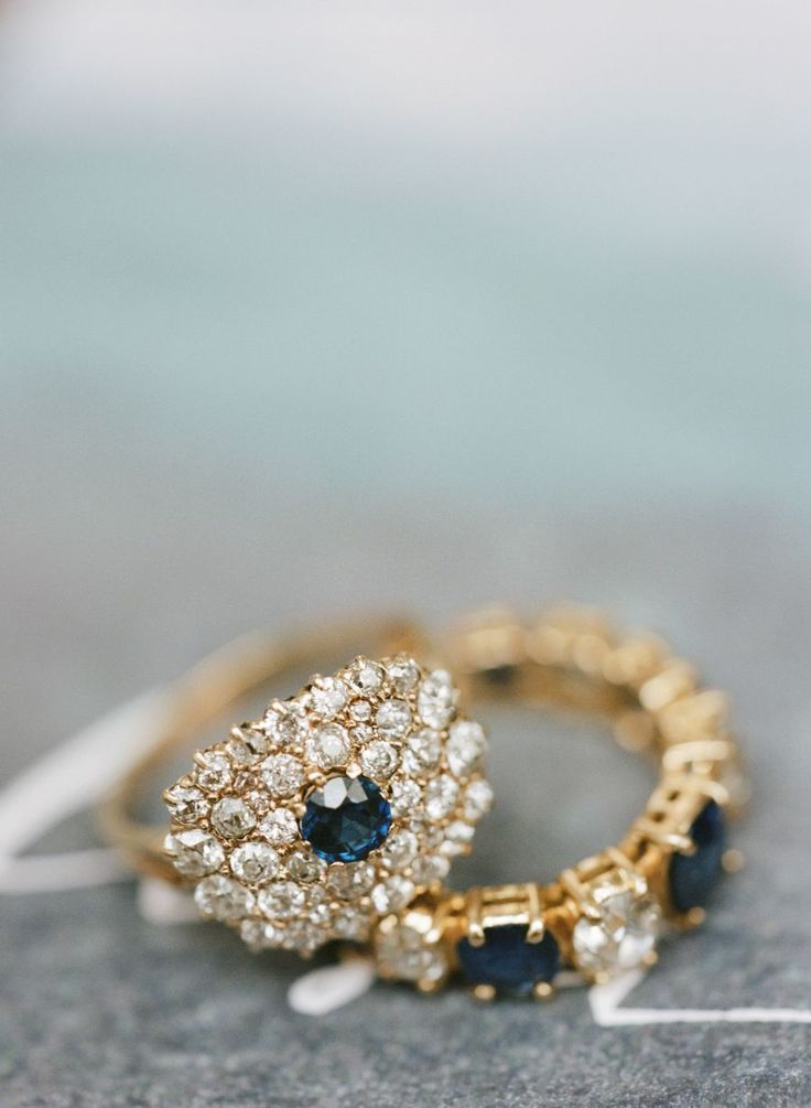 sapphire and diamond cluster engagement ring and gold band | Photography: Elisa ...
