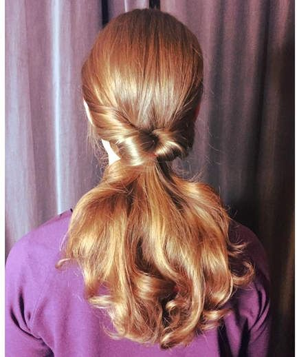 Inside-Out Ponytail | Give your pony a sophisticated twist with this easy hairst...