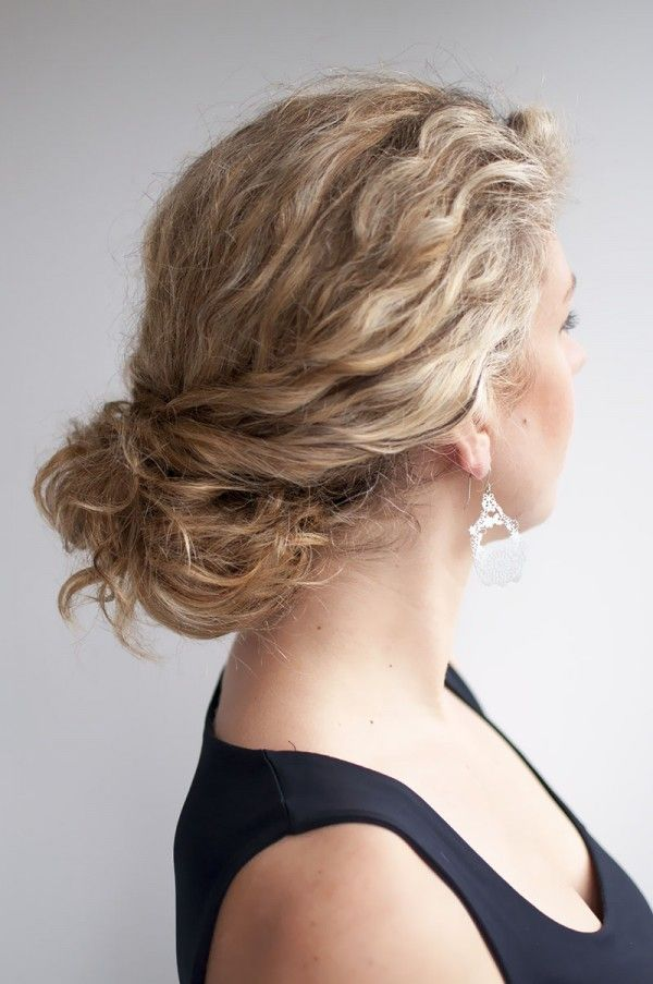 Messy twisted bun for curly hair. Get the how-tos....