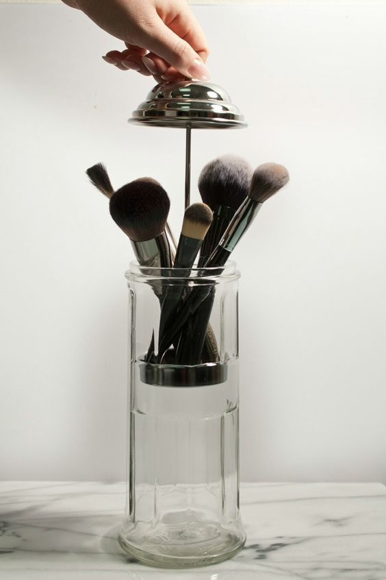 A vintage straw dispenser means dust-free makeup brushes. (Plus, it's pretty...