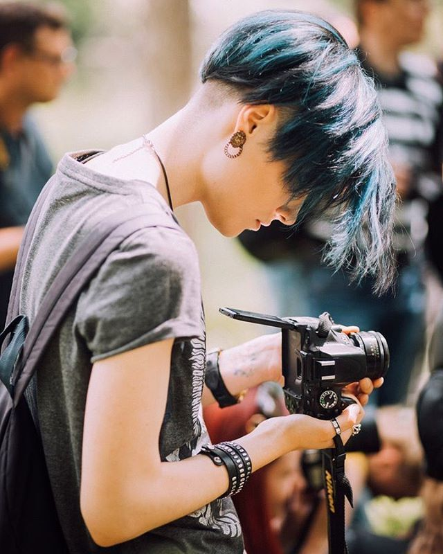 Leather bracelet, T-shirt, blue hair....