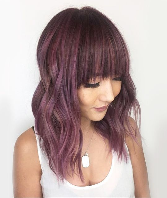 Dusty rose is the latest pink hair shade variation the internet is swooning over...