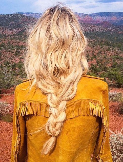 braided hair and fringe jacket to take on the dessert
