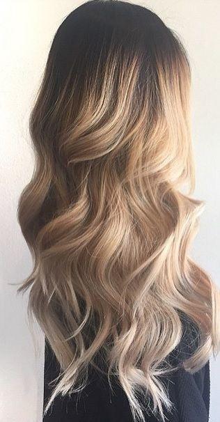 long wavy layered hairstyle