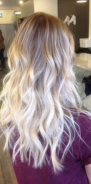 Nice color melt here – from a light natural blonde to platinum ends. Color by ...