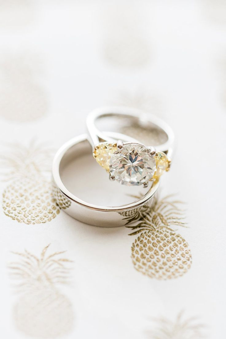 Brilliant cut engagement ring with fancy yellow diamond baguettes. Photography :...