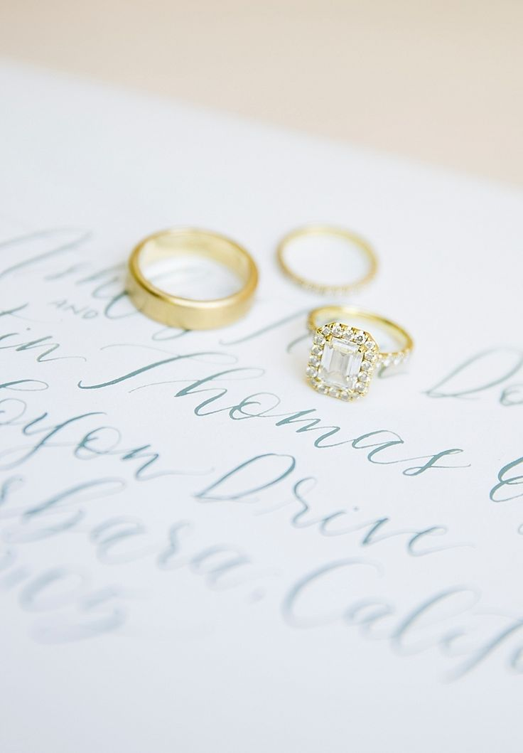 Cushion cut gold band halo setting engagement ring: Photography: Kristen Beinke ...