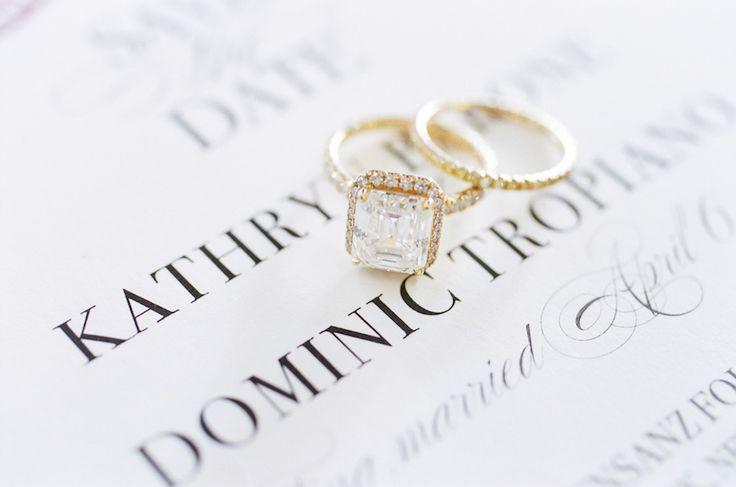 Cushion-cut halo setting gold diamond ring: www.stylemepretty... Photography: Al...