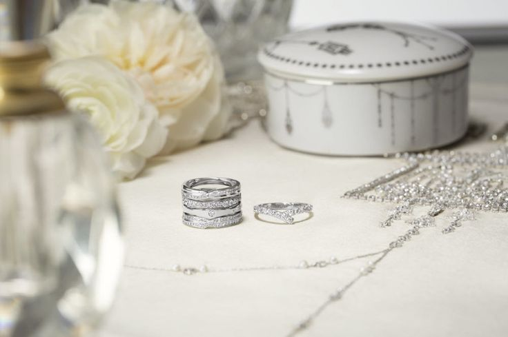 Embrace the curves of a diamond center stone with a Harry Winston Wave Wedding B...