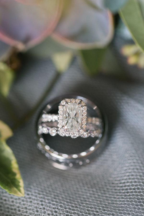Emerald-cut diamond ring in a halo setting: www.stylemepretty... Photography: Am...