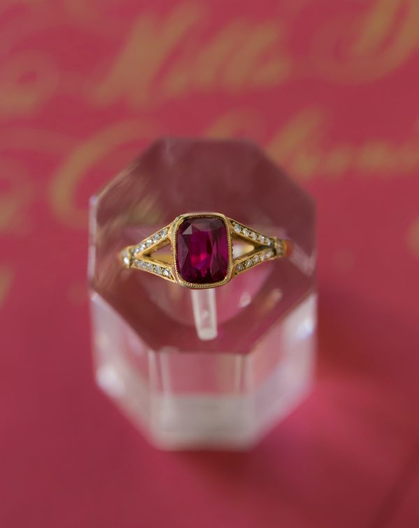 Garnet cushion cut engagement ring: www.stylemepretty...