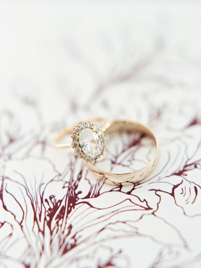 Gold oval-cut engagement ring in a halo setting: www.stylemepretty... Photograph...
