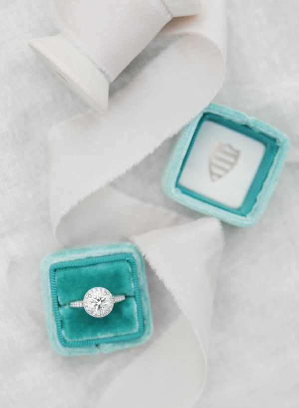 Gray and teal round-cut diamond ring: www.stylemepretty...