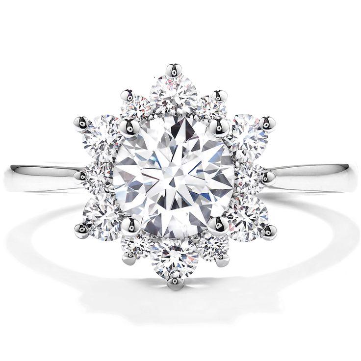 Hearts on fire circle-cut diamond ring: www.stylemepretty...