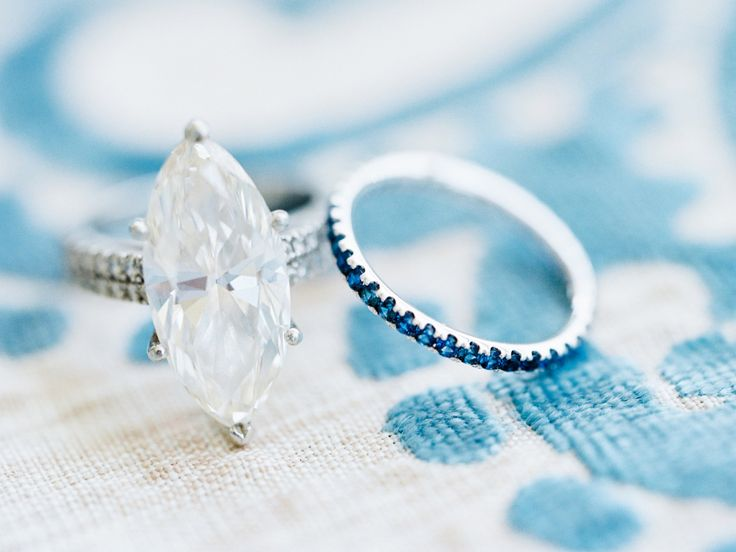 Marquise cut engagement ring with a topaz blue wedding band: www.stylemepretty.....