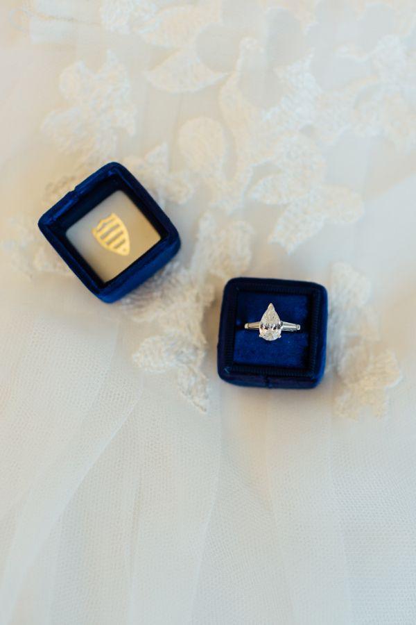 Modern pear-cut engagement ring: www.stylemepretty... Photography: Tim Tab Studi...