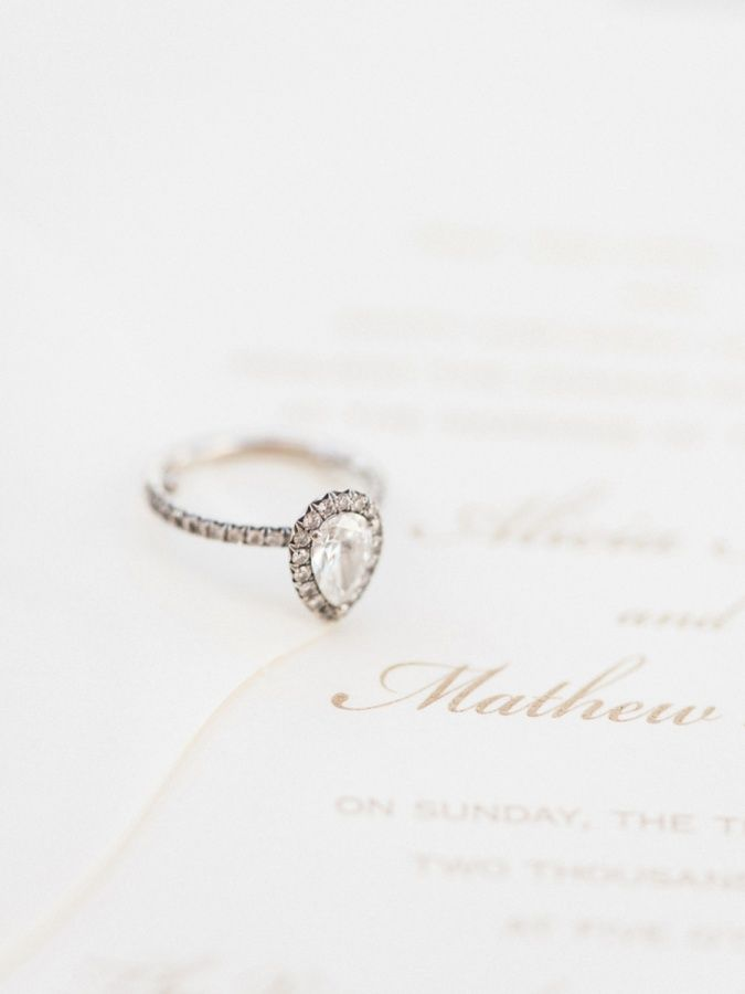Obsessing over this pear cut halo engagement ring! www.stylemepretty... | Photog...