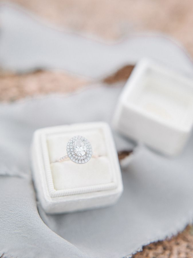 Oval-cut diamond ring in a double halo: www.stylemepretty... Photography: Tenth ...