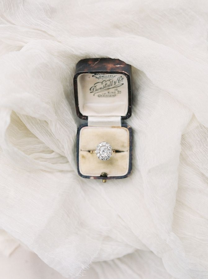 Oval-cut diamond ring in a halo setting: www.stylemepretty... Photography: Simpl...