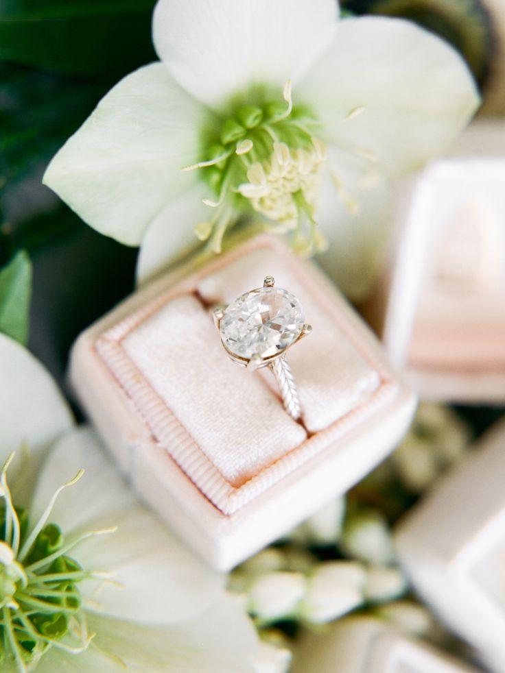 Oval-cut engagement ring: Styling: Natalie Bray Studios - nataliebray.comFl... :...