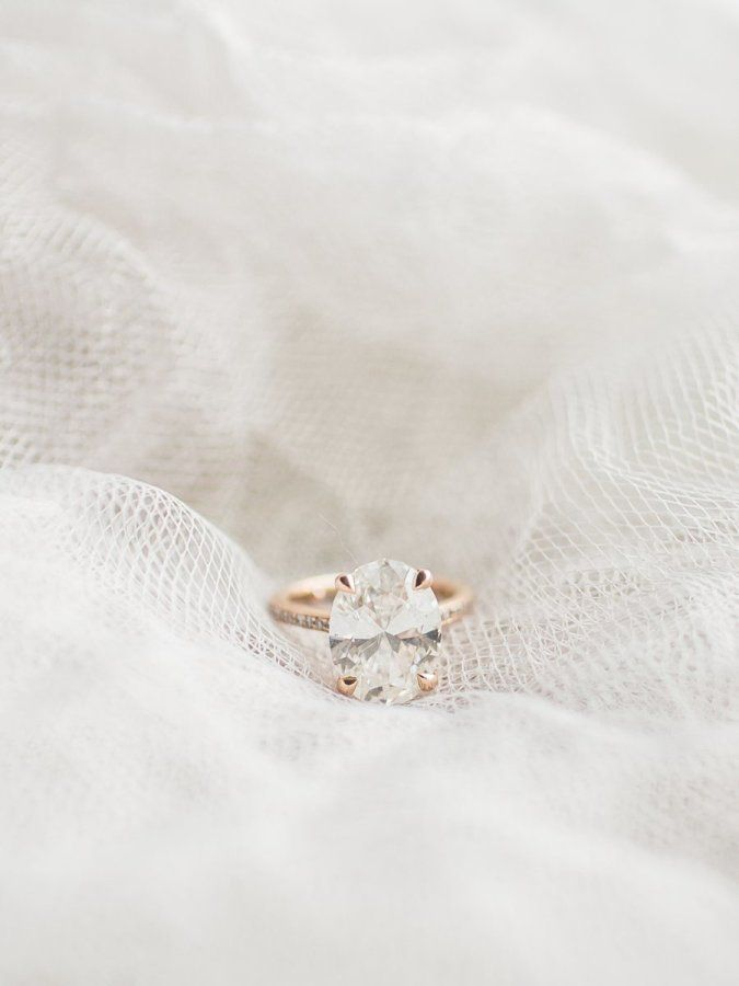 Oval-cut modern rose gold engagement ring: www.stylemepretty... Photography: Lau...