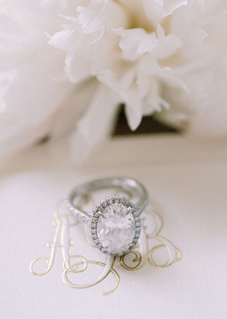 Oval-cut with halo engagement ring: Photography: Blaine Siesser - www.blainesies...