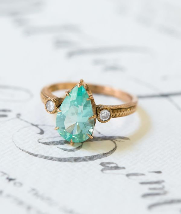 Pear cut blue diamond gold band ring: www.stylemepretty...