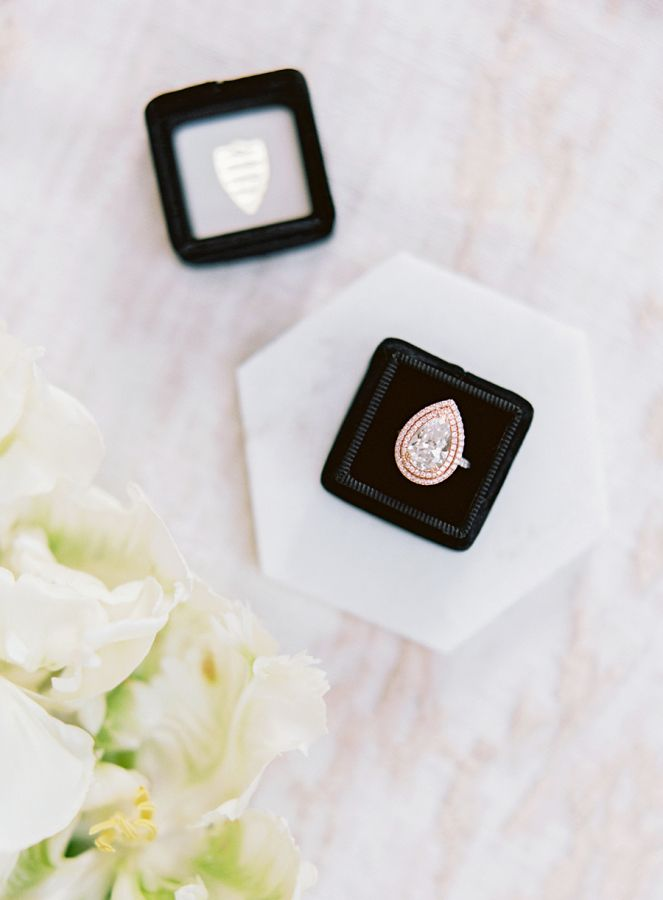 Pear-cut engagement ring in a halo setting: www.stylemepretty... Photography: Sa...