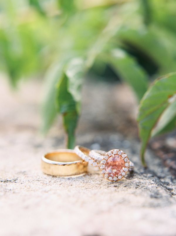 Pink diamond gold ring in a halo setting: www.stylemepretty...