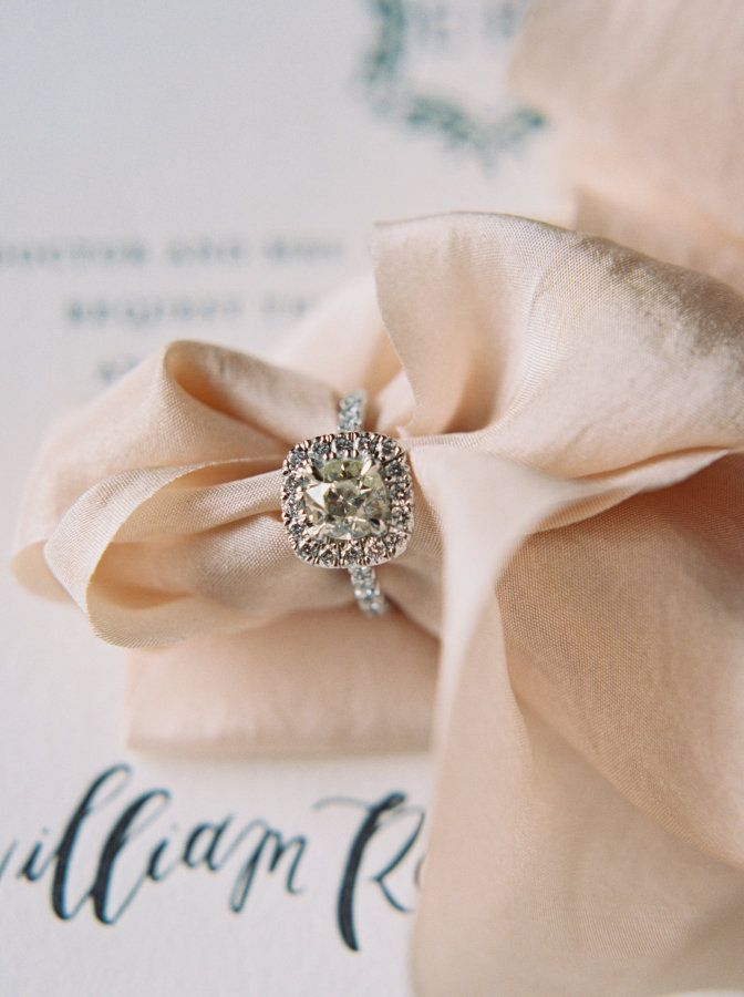 Round-cut diamond in a halo setting: www.stylemepretty... Photography: Kristin S...