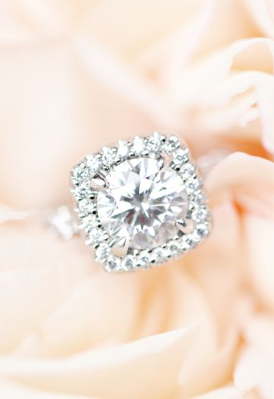 Round-cut diamond ring with a square halo setting: www.stylemepretty... Photogra...