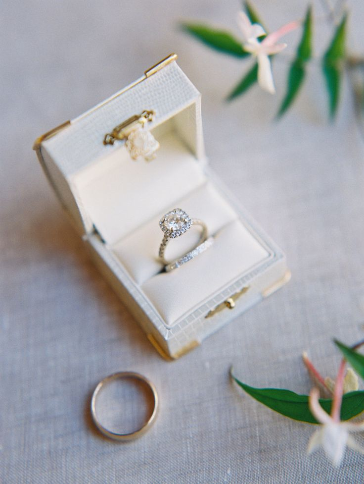 Round-cut engagement ring in a halo setting: Floral Design: Fionna Floral - www....
