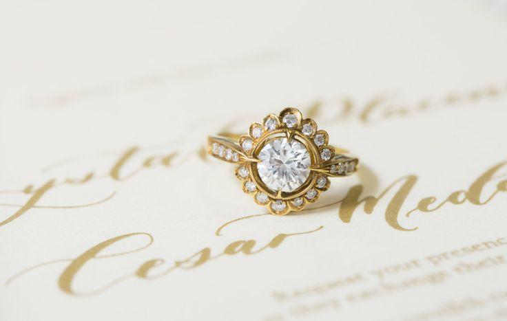 Round cut flower petal gold band diamond ring: www.stylemepretty...