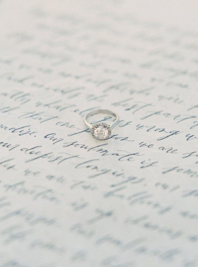 Round cut halo setting white gold diamond ring: www.stylemepretty... Photography...
