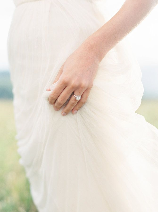 Simplistic diamond halo setting white gold ring: www.stylemepretty... Photograph...