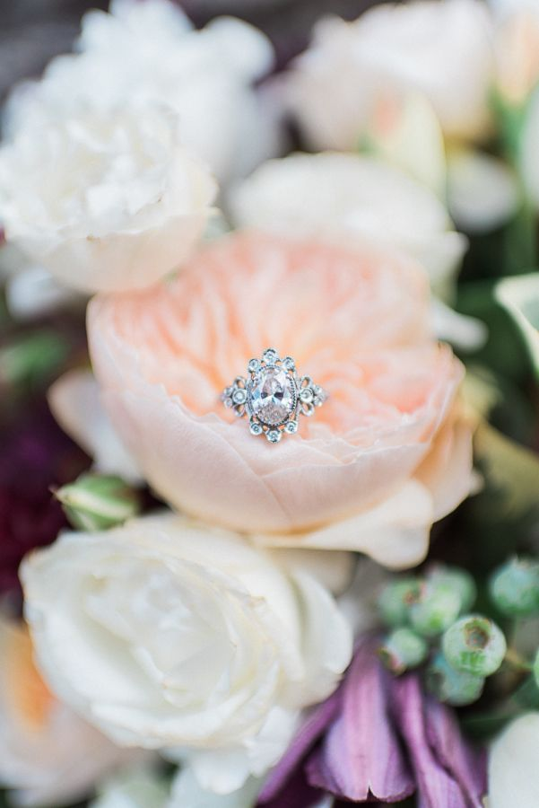 Soft peach and ivory roses and a beautiful unique diamond ring: www.stylemeprett...