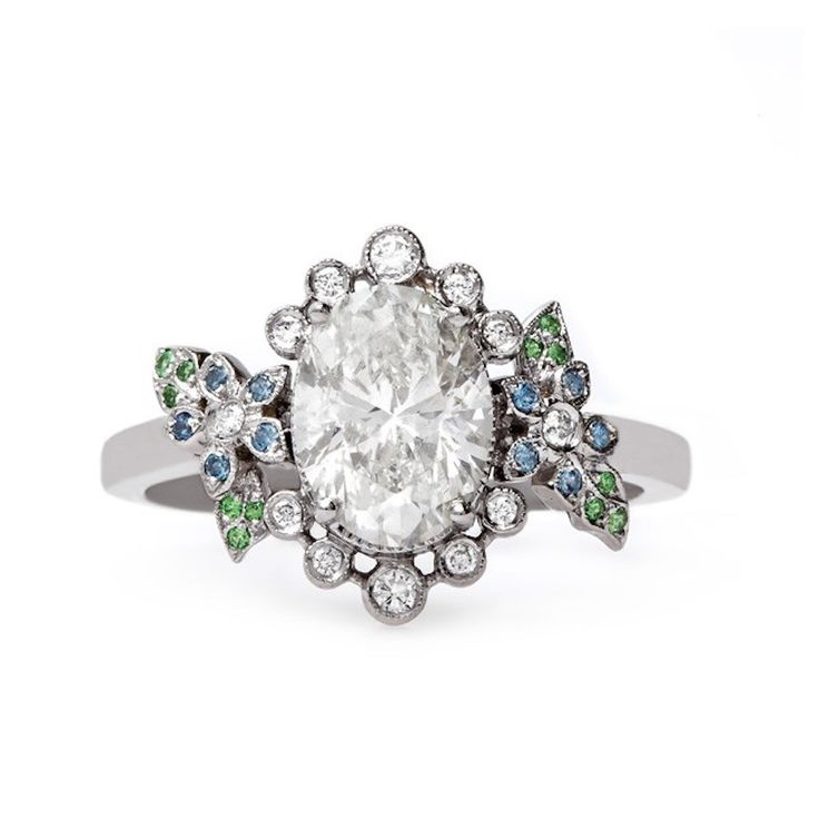 Trumpet & Horn oval-cut diamond ring with colorful embellishment: www.stylemepre...