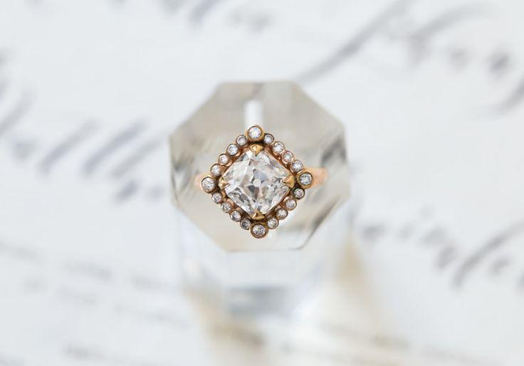 Vintage cushion cut halo setting engagement ring: www.stylemepretty...
