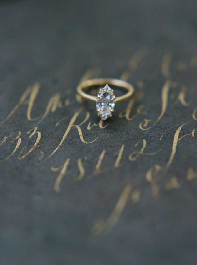 Vintage marquise-cut gold engagement ring: www.stylemepretty... Photography: Kat...