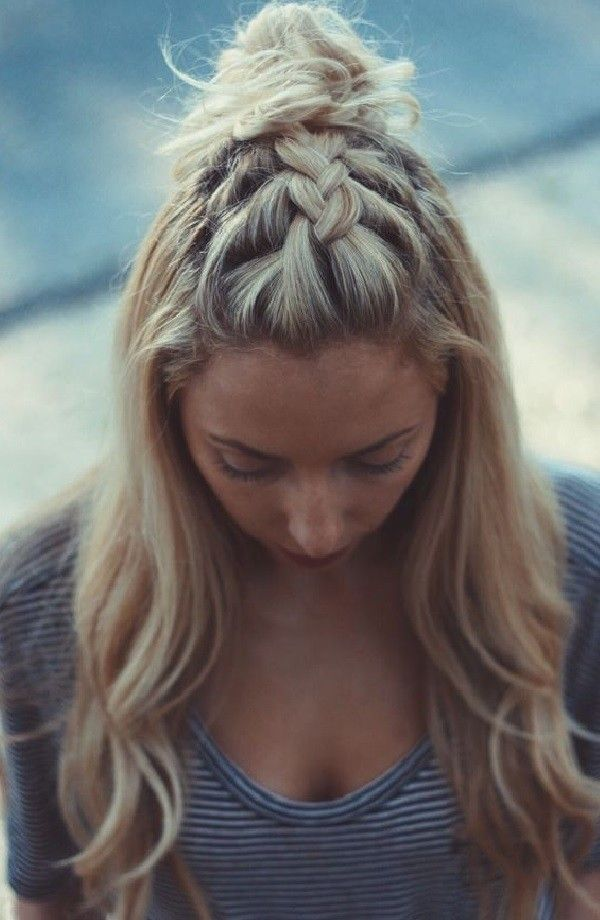 A partial French braid that ends in a top knot. Lovely! Originally pinned from k...